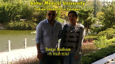 Dr Shamik Majumdar with student in ahmu